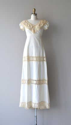 Vintage 1960s cotton-linen blend wedding gown by Bianchi with french vanilla cotton crochet V neckline, short puff sleeves trimmed in crochet, empire