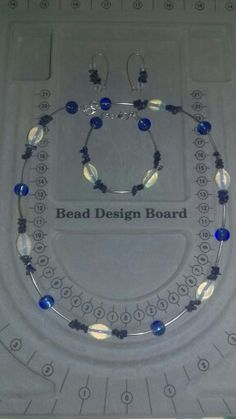 Lapiz lazuli stone chips, silver tube spacers, blue beads and opalite ovals. Set made as a birthday gift for my lovely Mum.