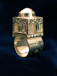 Traditional Jewish wedding ring by Ethan Wilcox. The building represents both the Temple in Jarusalem, and the new home the couple is to create.