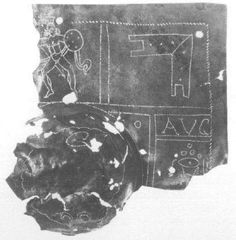 Remains of a Roman scutum shield boss. Once belonged to a legionary of Legio VIII Augusta. You can still read the AVG(VSTA) inscribed on the metal.