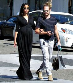 Zoe Saldana wore a comfy black maxi dress to visit a maternity wear boutique with her hubby http://dailym.ai/1ojr8UE