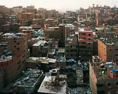 Princen, Mokattam Ridge (Garbage city), Cairo. A bustling place where people live among the garbage which they recycle and sell.