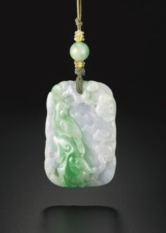 A GREEN AND LAVENDER JADEITE PENDANT  QING DYNASTY, 19TH CENTURY