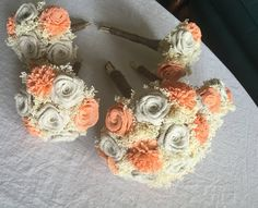 $60 Medium Bridal- Ivory and Light Coral Bridal Bouquet. Features 17 handmade flowers with hand dyed sola flowers. Small Bridesmaids are $22/each.  Remember to order at least 6 months ahead of time if interested!  Than you!