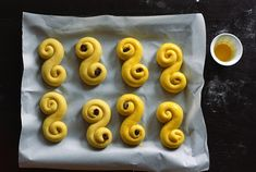 13 the Scandinavian countries celebrate St. Lucia day with special saffron buns called Lussekatter or Lussebullar. Swedish Christmas Food, Swedish Bread, Pearl Sugar, Egg Wash, Bread And Pastries, Dry Yeast, Cinnamon Rolls, Raisin, Play Dough