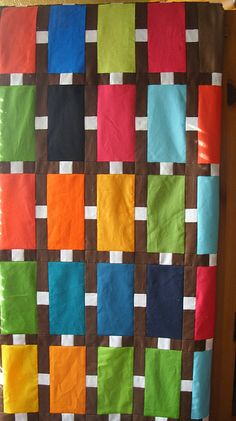 So interesting to see this pattern opened up, using solids and w/o the colorful rectangles framed. City Lot by cherry house quilts, via Flickr