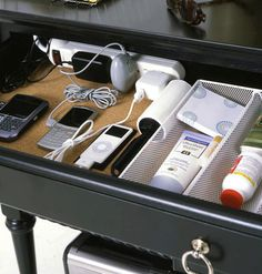 Smart Drawer - Create a charging station, mount a power strip in the bakc of the buffet drawer and drill a hole through the back of the piece for the cord.  Dock cell phones, MP3 players, and other electronics.