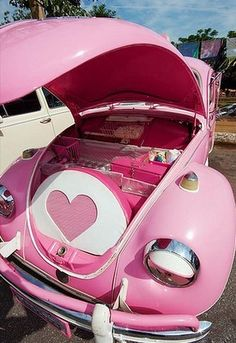 pink vintage VW car auto with trunk space in front of drivers' seat - best gas mileage i ever had - i miss my bug!!