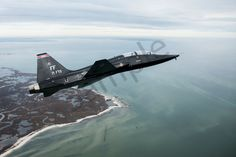 151207-f-kb808-121 - A T-38 Talon approaches the Atlantic Ocean after departing from Langley Air Force Base, Va., Dec. 7, 2015. As part of the Trilateral Exercise, the Talon's will be acting as adversary aircraft. (U.S. Air Force photo by Senior Airman Kayla Newman)