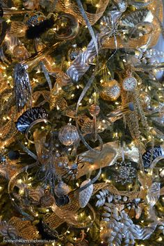 Tree decorated to ring in the new year with a hat tree topper, party horns, tiaras and confetti streaming ribbon New Years Eve Decorations, Christmas Tree Decorations, Christmas Wreaths, Christmas Ideas, New Year's Eve Celebrations, New Year Celebration, Mini Desserts, Holiday Tree, Holiday Fun