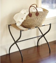 A luggage rack(because it is a guest room) that ties in with the room nicely.