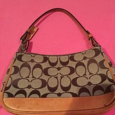 Coach small pocketbook Authentic tan and brown classic pattern coach pocketbook. One inside pocket. Zipper top. Honey brown leather trim. Note all the water stains on leather. This is sold as is. Coach Bags