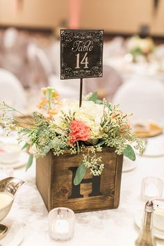 Table number as part of rustic style centerpeice, photographed by Rachel Solomon