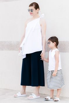 Mother - Daughter Mini Me outfit feat. COS bow one-shoulder top, Zara culottes, Douuod Kids bow top and striped skirt, and Nike pool slides