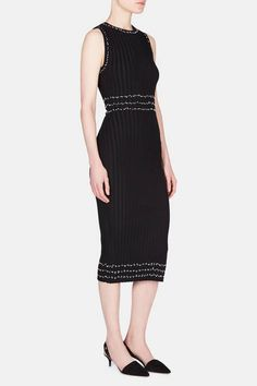 For spring 2016, designer Joseph Altuzarra injects a sense of the handmade into classic silhouettes. This sleeveless sheath is also a subtle allusion to the traditional Basque costumes that also inspired the collection. The sleek black dress is punctuated by delicate yet striking contrast trim of knotted embroidery that encircles the crewneck, armholes, and waist. Made of stretch-infused viscose, the fine-gauge knit gains further dimension from ribbing and a side slit.
