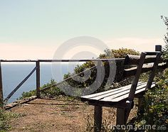 Mountain peak wooden bench sky and sea view