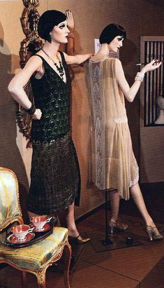 From an exhibition of cocktail couture by the Onondaga Historical Association. From its collection, left: 1925 green and silver lamé Worth dress with gold & silver leather hip decoration. Right: 1925 oyster silk Georgette dress trimmed with white seed beads in an Art Deco pattern. Mannequins painted and photo by dashndazzle.