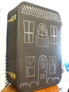 What's not to love? Take an old suitcase, add chalkboard paint, suitcase and it becomes a dollhouse!