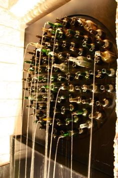 Gorgeous wine bottle wall fountain; change shape, depths and light; wine room or outside - pretty cool! #GWF2013