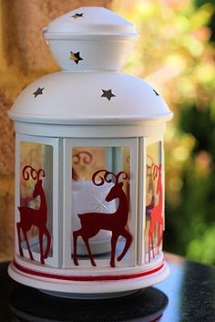 Your Christmas decorations will be the talk of the season if you design a Christmas Lantern. Use paper cutouts of Christmas characters and craft ribbon to dress up a chic lantern that can be both an indoor or outdoor Christmas decoration. All Things Christmas, Christmas Home, Christmas Holidays, Christmas Ornaments, Ikea Christmas Presents, Christmas Lantern Diy, Reindeer Christmas, Christmas Ribbon, Christmas Photos