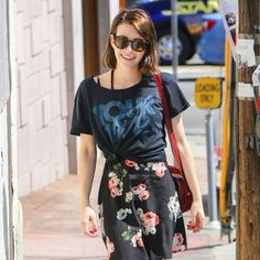 Emma Roberts flaunted a girly-meets-rocker look with a floral skirt and cute retro round sunnies, juxtaposed with a band tee and booties!