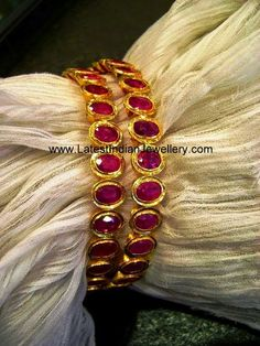 Beautiful designer gold bangles pair in 22 karat with oval shaped pink rubies studded around the bangles. Plain Gold Bangles, Ruby Bangles, Gold Bangles Design, Gold Jewellery Design, Antique Jewellery, Ruby Jewelry, Bridal Jewelry, Gold Jewelry, Gold Necklace