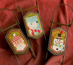 Decorate your tree with these wonderful cross stitched ornaments: Let's Go Sledding!