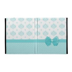 A cute and girly aqua and white iPad Folio case with stylish polka dots and a vintage damask pattern. This feminine design has a pretty double bow.