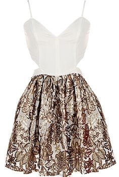 Foiled Flowers Dress: Features an elegant duo-fabric design with a solid ivory upper portion, fully adjustable spaghetti straps, sexy cutout sides, and a flared ballerina skirt covered in shimmering sequin flowers to finish.