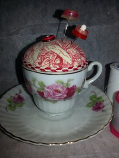 Pincushion in a vintage cup https://www.etsy.com/listing/167907504/pincushion-in-a-beautiful-rose-pattern