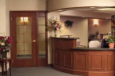Like the warm, inviting feel of the woodwork dental office reception design | DENTAL INTERIOR OFFICE DESIGNS | DESIGN INTERIOR
