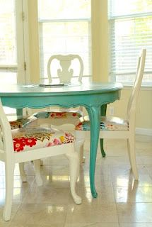 LOVE this table and chairs. The only thing I would change is having a stained wood top.