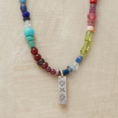 RAINBOW OF COLOR NECKLACE -- Gemstones put on a dazzling display of color, dotted here and there with cultured pearls and glass beads. Thai silver tab charm