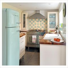 turquoise refrigerator, wood counter tops