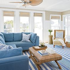 Bright white wall paneling and ceiling beams provide visual heft to this space. | Coastalliving.com