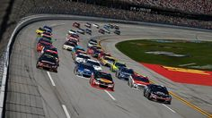 TALLADEGA, AL - MAY 03: General view as Tony Stewart, driver of the #14 Bass Pro Shops/Tracker Boats Chevrolet, and Kasey Kahne, driver of the #5 Farmers Insurance Chevrolet, lead the field in a restart during the NASCAR Sprint Cup Series GEICO 500 at Talladega Superspeedway on May 3, 2015 in Talladega, Alabama.  (Photo by Jeff Zelevansky/NASCAR via Getty Images)