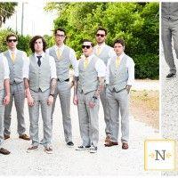 light gray suite and yellow ties. Men gotta wear stunna shades