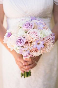 Romantic bridal bouquet of roses, dahlia, freesia, scabiosa, stock and mums in hues of soft lavender, blush, peachy pink, and cream. Visual Impact Design, Sacramento Wedding Flowers | Codrean Photography