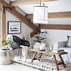 Here's an idea how to arrange the attic and make your little corner for relaxing with a good book. The most effective part of furniture is this old table that fits perfectly with other modern furniture.