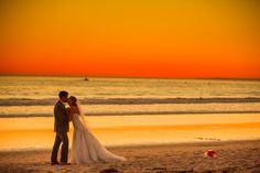 Sunset wedding photos in front of luxury hotel Shutters on the Beach - Santa Monica, California. (Photo by Laura Grier) Beach Wedding Bridesmaids, Beach Wedding Reception, Beach Wedding Photos, Sunset Wedding, Beach Wedding Invitations, Beach Weddings, Event Venues, Santa Monica, California