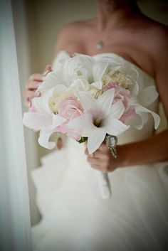 This beautiful bouquet is made with high quality silk lilies, orchids, tea roses, real touch light pink/blush roses and natural preserved babys breath. Measures 12 across. Custom requests are accepted to matching boutonnieres and corsages. White Lily Bouquet, Lily Bouquet Wedding, Small Bridal Bouquets, Orchid Bouquet, Blush Bouquet, Lily Wedding, Bride Bouquets, Bridal Flowers, Greenery Bouquets