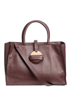 Leather handbag with two handles, detachable shoulder strap, and zip at top. Three inner compartments, one with zip. Tab at top with a round metal end in metal and leather. Metal studs on base. Size 5 x 10 x 15 in. Fall Handbags, Luxury Handbags, Purses And Handbags, Leather Handbags, H&m Online, Tabata, Beautiful Bags, Shopping Bag, Elsa