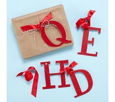 red letter - could do this with each of the kids initials as the tag to identify which gift goes where