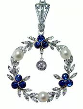 Antique Rose Cut Diamonds, Sapphires and Pearls in white gold.