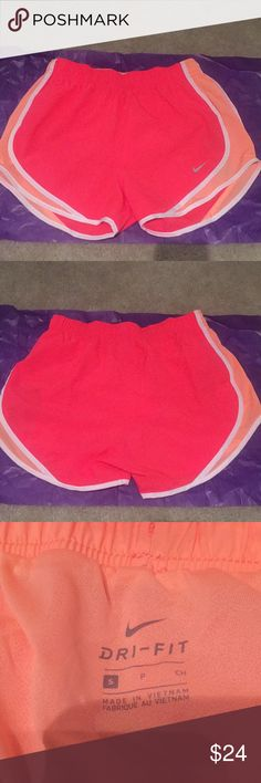 NWT Nike dry-fit shorts NWT. Perfect condition. Dry fit shorts. Great for running or exercising. Have an inner lining under the shorts.  Are hot pink/coral and sherbert orange Nike Shorts