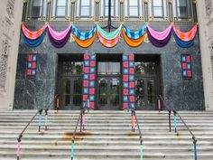Yarn bombing of Philadelphia Museum of Art by Jessie Hemmons with Lion Brand Yarn for Craft Spoken Here exhibit; May 5-Aug 12