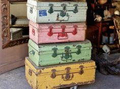 Old suitcases in darling colors.