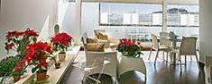 Chiudi il tuo spazio con delle vetrate panoramiche. Crea il tuo giardino d'inverno