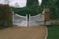 Wooden Swing Gates.  Visit http://www.frontline-auto.com/