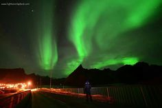Aurora display seen over a small fishing village on the Lofoten archipelago of Norway.